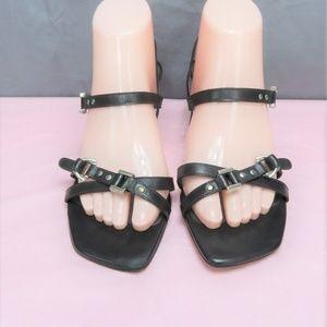 Black Strappy Leather Sandals By Stuart Weitzman